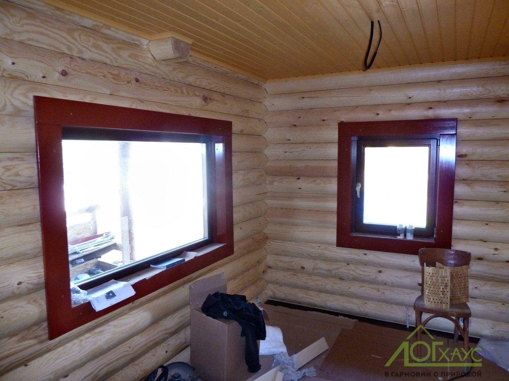 Установка деревянных окон и наличников в срубе