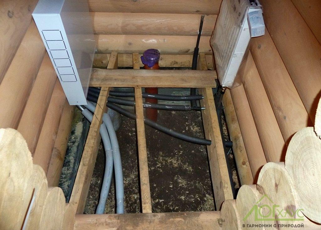 Монтаж инженерии в срубе бани из бревна