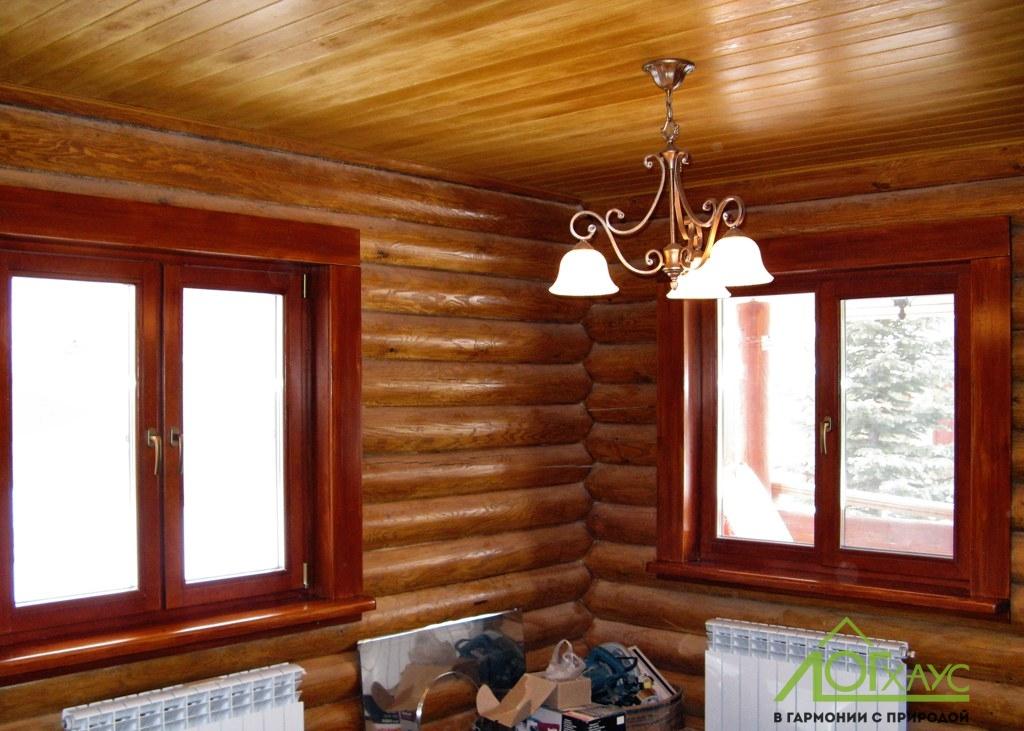 Монтаж освещения и отделка деревянной бани из бревна