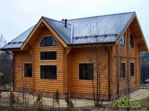 Дом из бревна оцилиндрованного