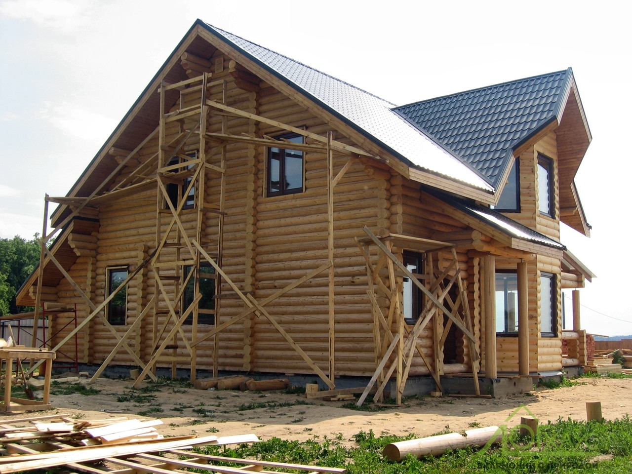 Шлифовка дома из бревна