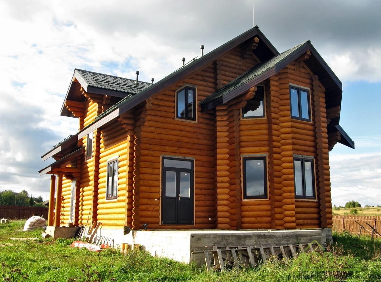 Дом из оцилиндрованного бревна по индивидуальному проекту