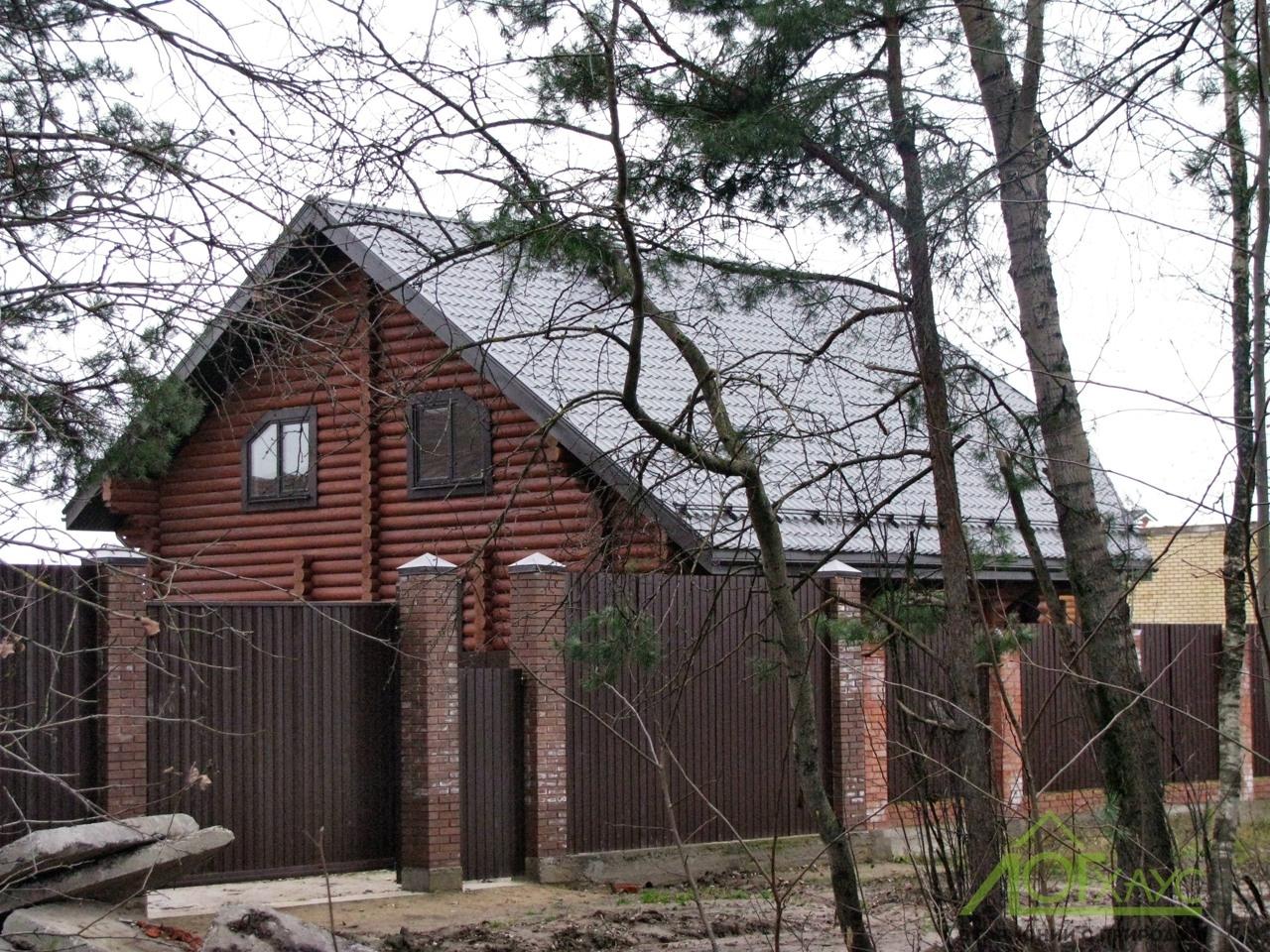 Дом из бревен по индивидуальному проекту