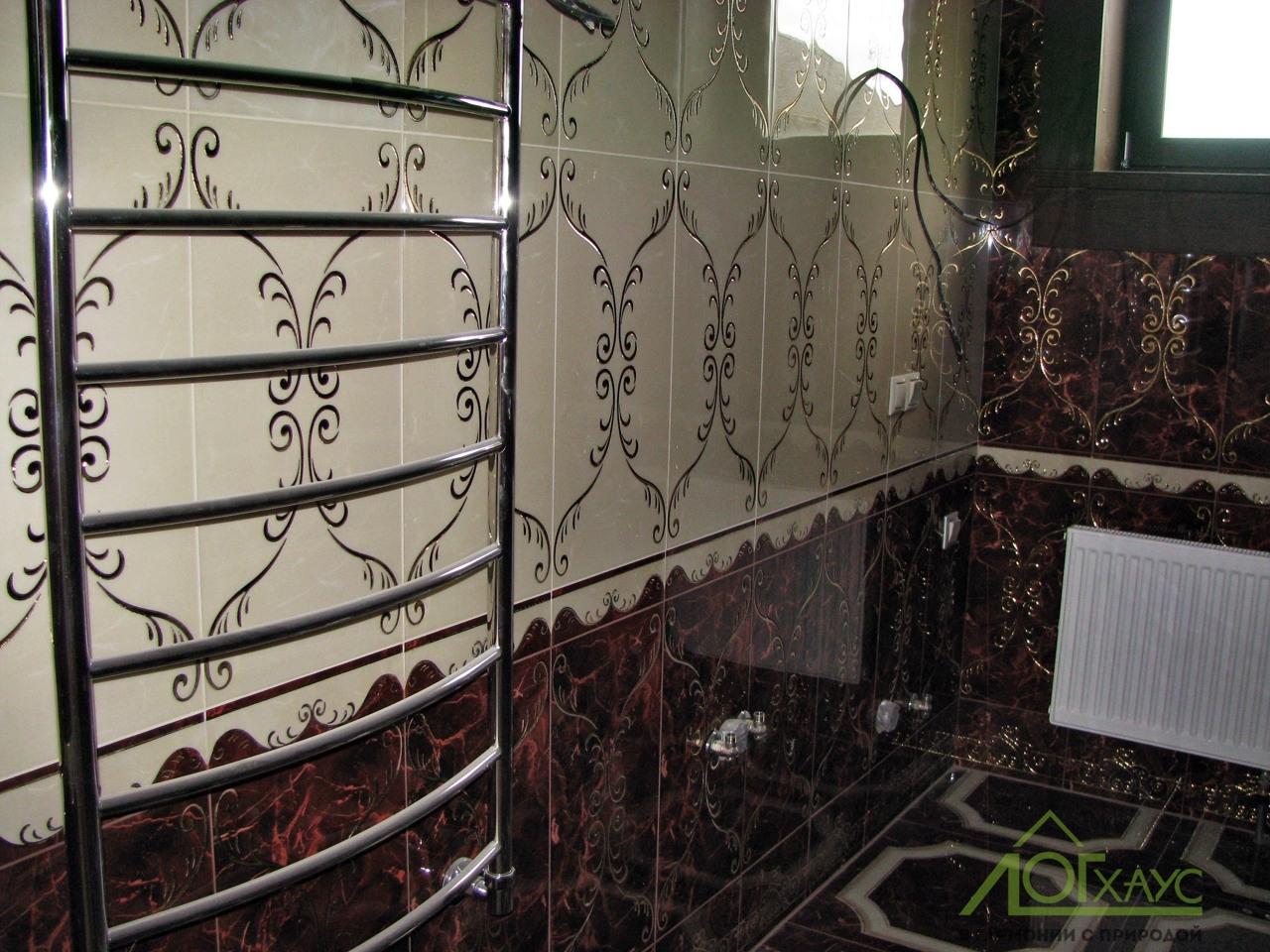 Установка полотенцесушителя в доме из бревна