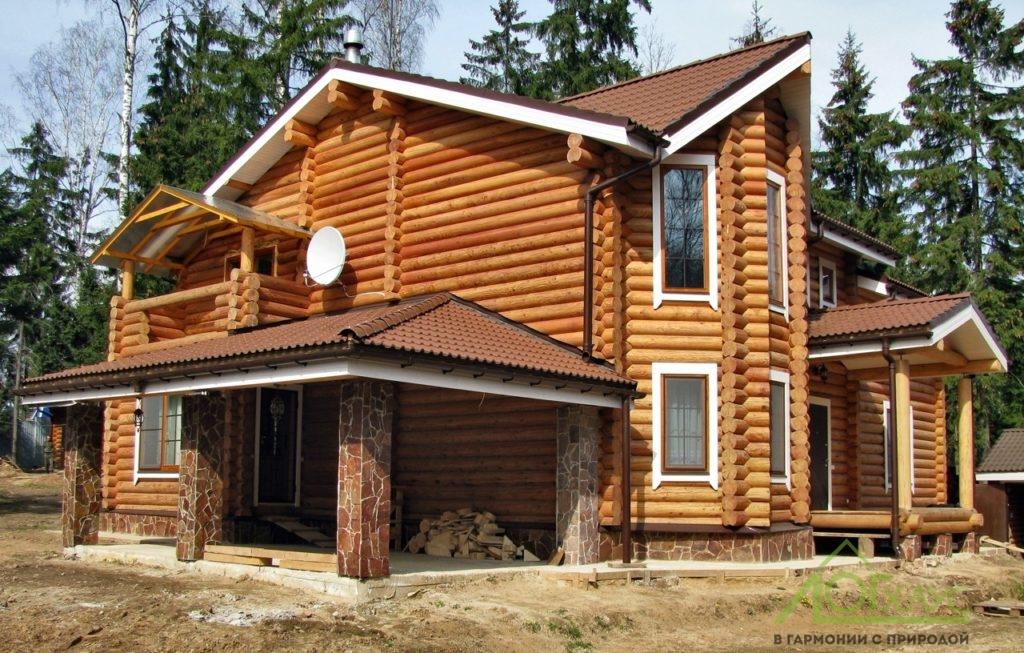 Дом из круглого бревна по частному проекту