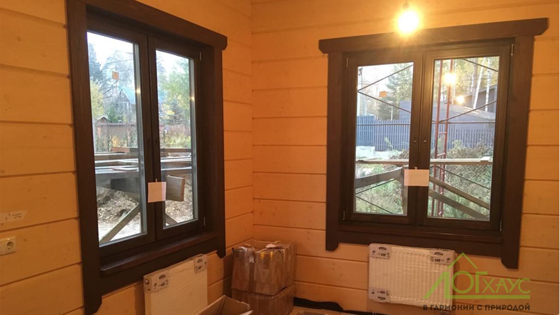 Окна и наличники в доме из клееного бруса