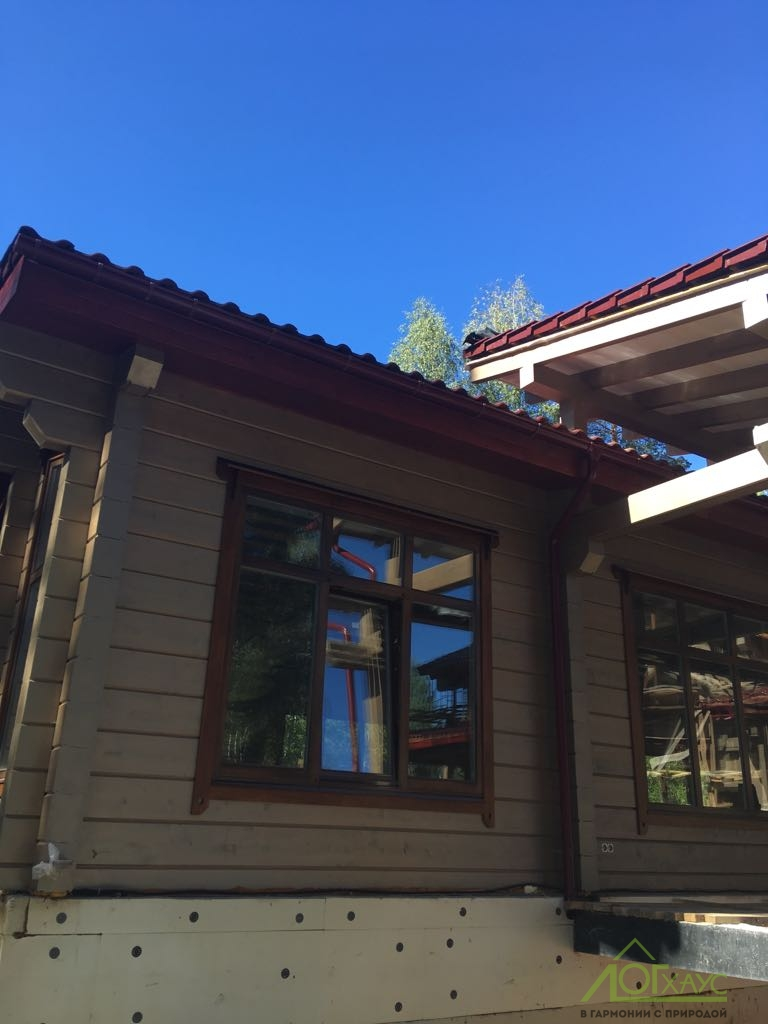 Наружная отделка деревянного дома из клееного бруса