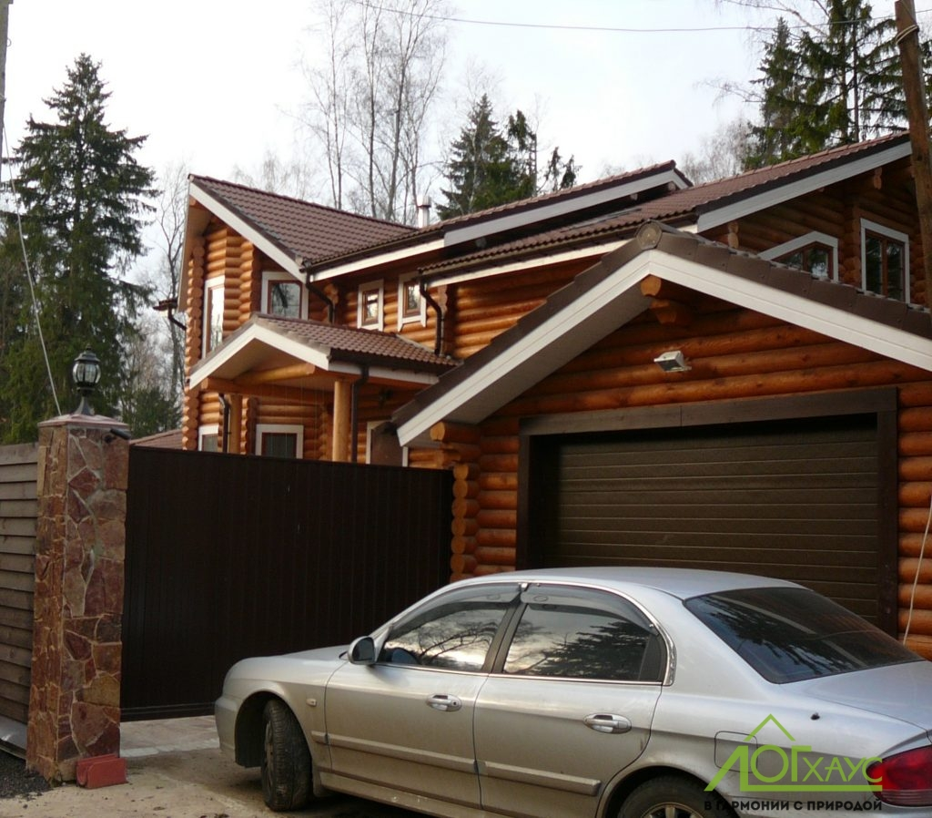 Дом из оцилиндрованного бревна с гаражом